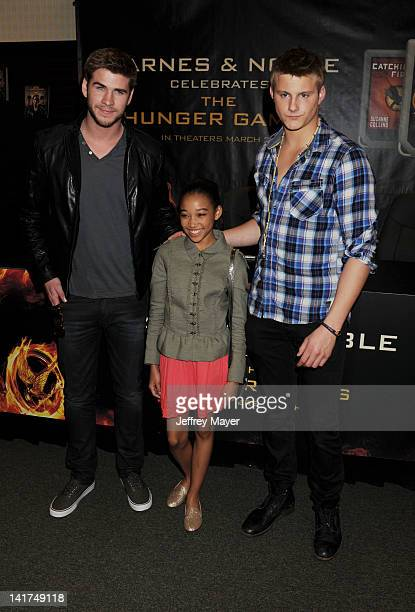 Liam Hemsworth Amandla Stenberg and Alexander Ludwig of Lionsgate's The Hunger Games pose at Barnes Noble bookstore at The Grove on March 22 2012 in...