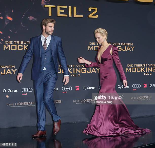 Liam Hemsworth and Jennifer Lawrence attend The Hunger Games Mockingjay Part 2 world premiere on November 04 2015 in Berlin Germany