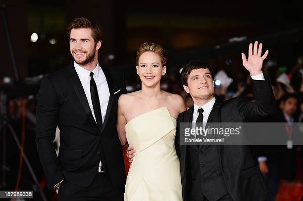Liam Hemsworth and Jennifer Lawrence with Josh Hutcherson attends 'The Hunger Games Catching Fire' Premiere during The 8th Rome Film Festival on...