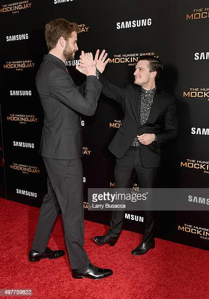 Liam Hemsworth and Josh Hutcherson attend The Hunger Games Mockingjay Part 2 New York Premiere at AMC Loews Lincoln Square 13 theater on November 18...