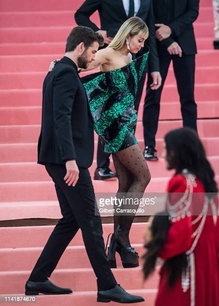 Liam Hemsworth and Miley Cyrus are seen arriving to the 2019 Met Gala Celebrating Camp Notes on Fashion at The Metropolitan Museum of Art on May 6...