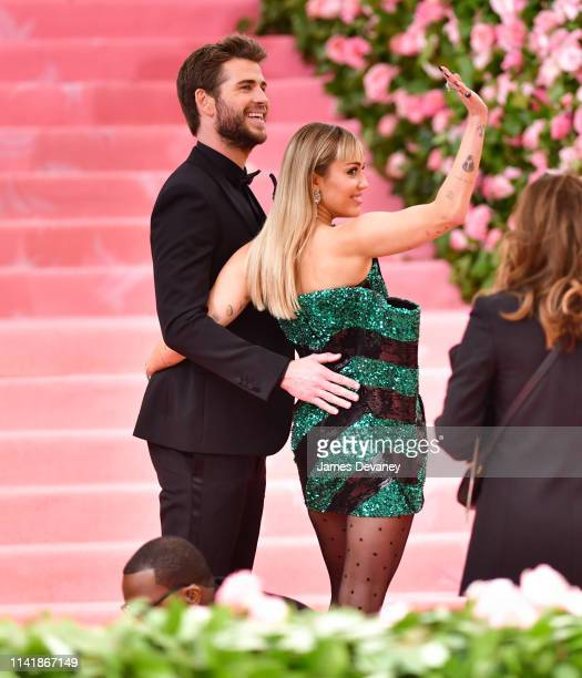 Liam Hemsworth and Miley Cyrus arrive to The 2019 Met Gala Celebrating Camp Notes on Fashion at Metropolitan Museum of Art on May 6 2019 in New York...