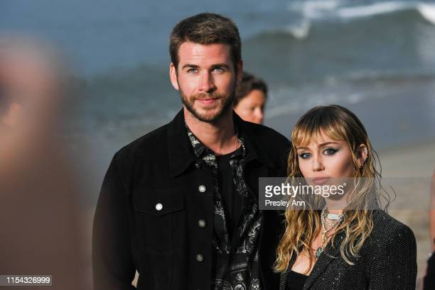 Liam Hemsworth and Miley Cyrus at Saint Laurent mens spring summer 20 show on June 06 2019 in Malibu California
