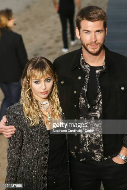 Liam Hemsworth and Miley Cyrus at Saint Laurent mens spring summer 20 show on June 06, 2019 in Malibu, California.