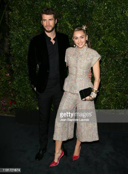 Liam Hemsworth and Miley Cyrus attend Charles Finch And CHANEL's 11th Annual PreOscar Awards Dinner at Polo Lounge at The Beverly Hills Hotel on...