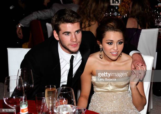 APPLY* Liam Hemsworth and Miley Cyrus attend the 18th Annual Elton John AIDS Foundation Academy Award Party at Pacific Design Center on March 7 2010...