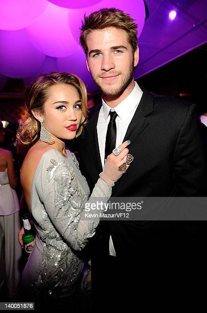 Liam Hemsworth and Miley Cyrus attend the 2012 Vanity Fair Oscar Party Hosted By Graydon Carter at Sunset Tower on February 26 2012 in West Hollywood...