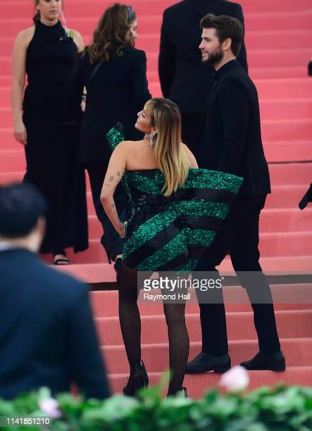 Liam Hemsworth and Miley Cyrus attend The 2019 Met Gala Celebrating Camp Notes on Fashion at Metropolitan Museum of Artat on May 6 2019 in New York...