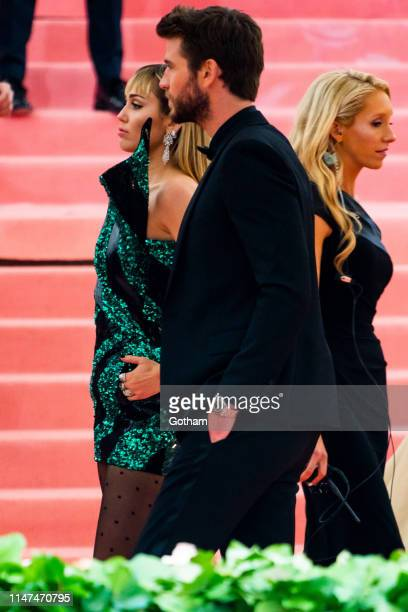 Liam Hemsworth and Miley Cyrus attend the 2019 Met Gala celebrating 'Camp Notes on Fashion' at the Metropolitan Museum of Art on May 06 2019 in New...