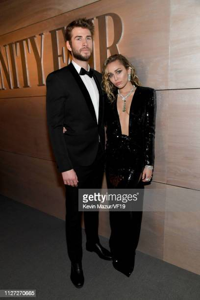 Liam Hemsworth and Miley Cyrus attend the 2019 Vanity Fair Oscar Party hosted by Radhika Jones at Wallis Annenberg Center for the Performing Arts on...