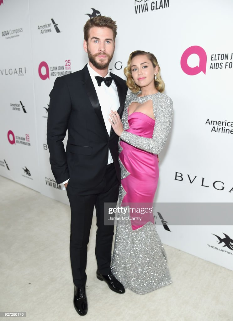 Liam Hemsworth (L) and Miley Cyrus attend the 26th annual Elton John AIDS Foundation Academy Awards Viewing Party sponsored by Bulgari, celebrating EJAF and the 90th Academy Awards at The City of West Hollywood Park on March 4, 2018 in West Hollywood, California.