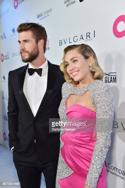 Liam Hemsworth and Miley Cyrus attend the 26th annual Elton John AIDS Foundation Academy Awards Viewing Party sponsored by Bulgari celebrating EJAF...