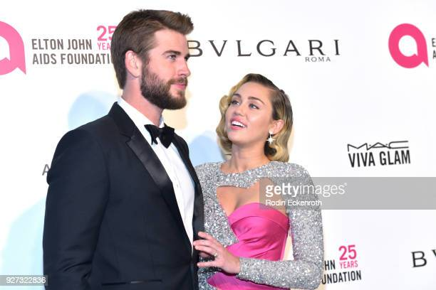 Liam Hemsworth and Miley Cyrus attend the 26th annual Elton John AIDS Foundation's Academy Awards Viewing Party at The City of West Hollywood Park on...