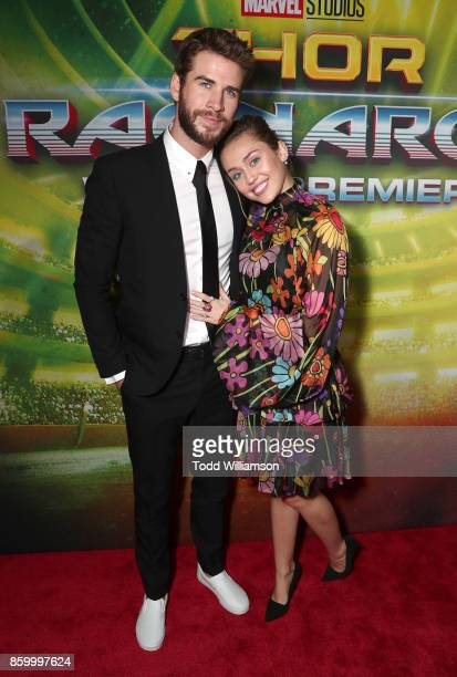 Liam Hemsworth and Miley Cyrus attend the premiere of Disney And Marvel's Thor Ragnarok on October 10 2017 in Los Angeles California