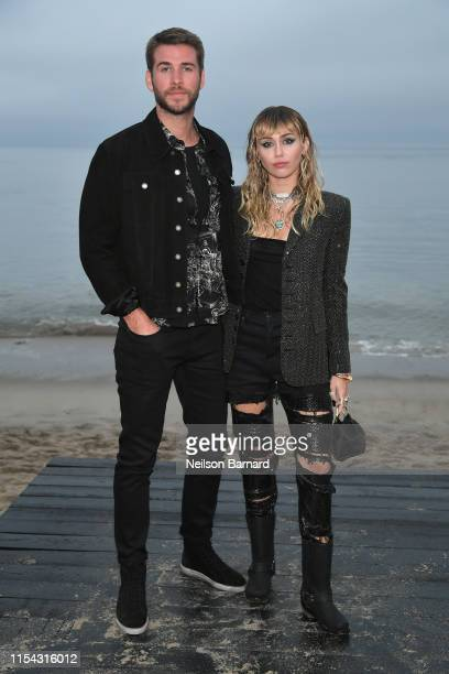 Liam Hemsworth and Miley Cyrus attend the Saint Laurent Mens Spring Summer 20 Show Photo Call on June 06 2019 in Malibu California