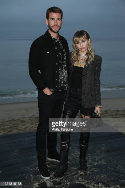 Liam Hemsworth and Miley Cyrus attend the Saint Laurent Mens Spring Summer 20 Show on June 6 2019 in Malibu California