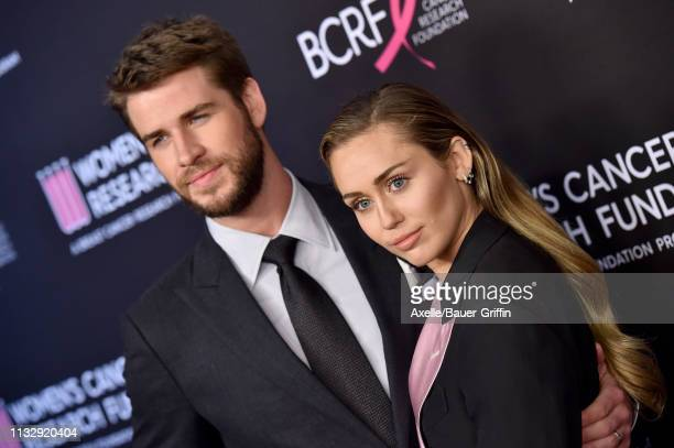 Liam Hemsworth and Miley Cyrus attend The Women's Cancer Research Fund's An Unforgettable Evening Benefit Gala at the Beverly Wilshire Four Seasons...