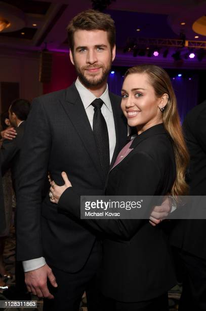 Liam Hemsworth and Miley Cyrus attend WCRF's An Unforgettable Evening at the Beverly Wilshire Four Seasons Hotel on February 28 2019 in Beverly Hills...