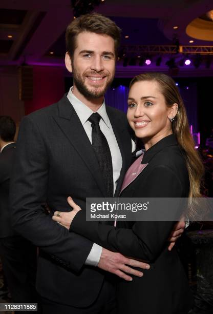 Liam Hemsworth and Miley Cyrus attend WCRF's 'An Unforgettable Evening' at the Beverly Wilshire Four Seasons Hotel on February 28 2019 in Beverly...