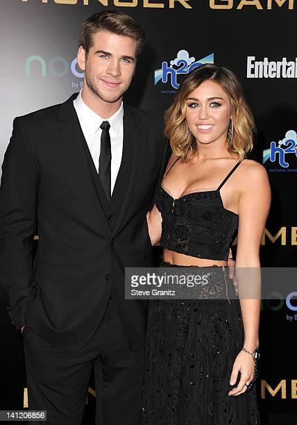 Liam Hemsworth and Miley Cyrus attends 'The Hunger Games' Los Angeles Premiere on March 12 2012 in Los Angeles United States