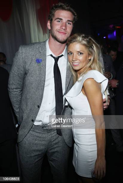 Liam Hemsworth and Yolanda Vendy pose for a photo during the Myer Derby After Dark at the Luminare on October 30 2010 in Melbourne Australia