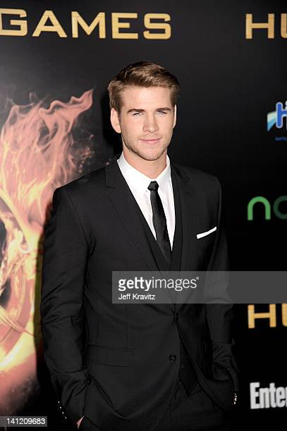 Liam Hemsworth attends The Hunger Games Los Angeles Premiere on March 12 2012 in Los Angeles California
