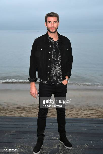 Liam Hemsworth attends the Saint Laurent Mens Spring Summer 20 Show on June 06 2019 in Paradise Cove Malibu California