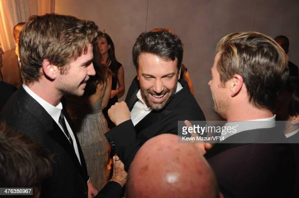 Liam Hemsworth, Ben Affleck and Chris Hemsworth attend the 2014 Vanity Fair Oscar Party Hosted By Graydon Carter on March 2, 2014 in West Hollywood,...
