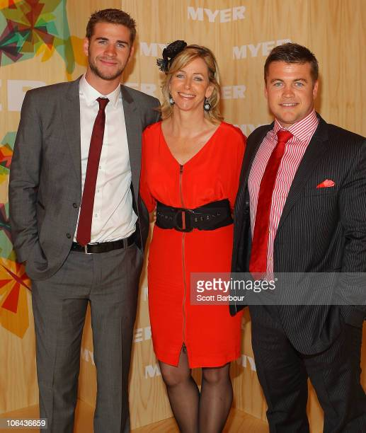 Liam Hemsworth his mother Leonie Hemsworth and brother Liam Hemsworth attend the Myer marquee during Emirates Melbourne Cup Day at Flemington...