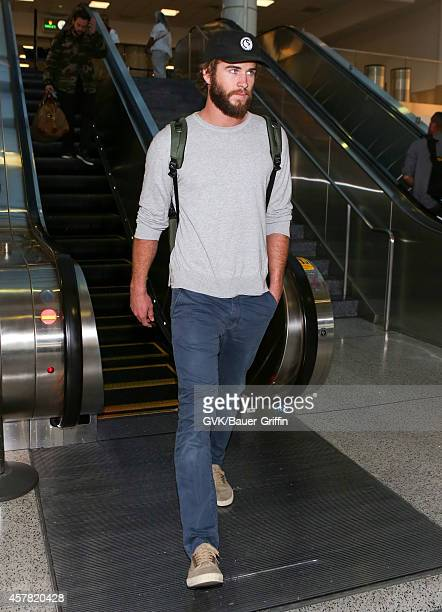 Liam Hemsworth is seen at LAX on October 25 2014 in Los Angeles California