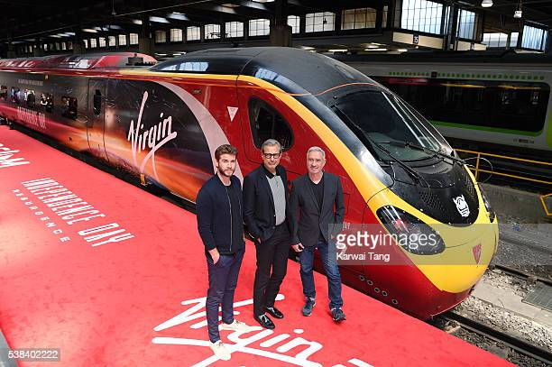 Liam Hemsworth Jeff Goldblum and Roland Emmerich attend the official unveiling of the Independence Day Resurgence wrapped train at Euston Station on...