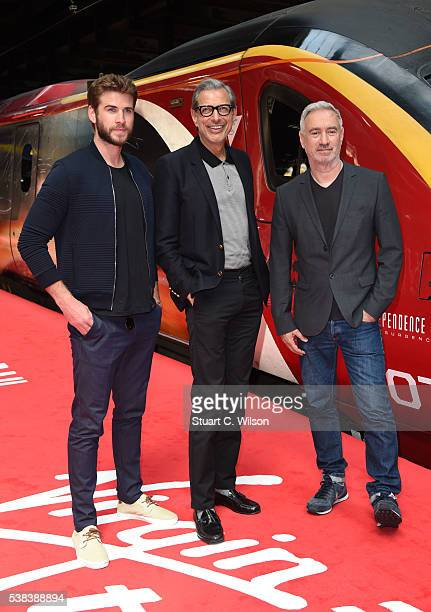 Liam Hemsworth Jeff Goldblum and Roland Emmerich took to Platform 16 at London Euston station today as Virgin Trains unveiled its new complimentary...