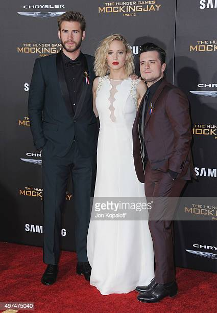 """Liam Hemsworth, Jennifer Lawrence and Josh Hutcherson arrive at the Los Angeles Premiere Of Lionsgate's """"The Hunger Games: Mockingjay - Part 2"""" at..."""