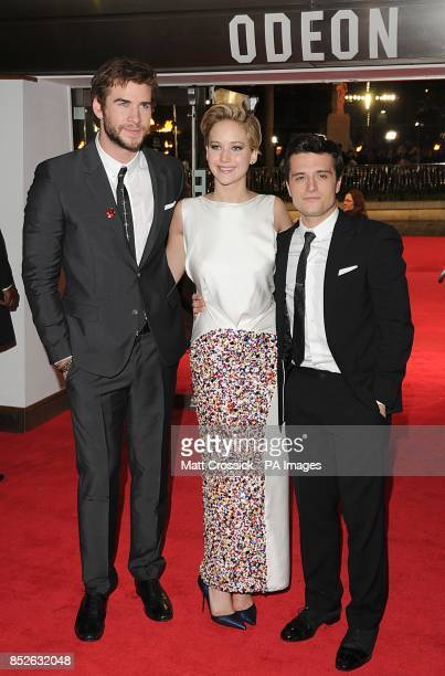 Liam Hemsworth Jennifer Lawrence and Josh Hutcherson arriving for the World Premiere of The Hunger Games Catching Fire at the Odeon Leicester Square...