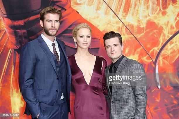 "Liam Hemsworth, Jennifer Lawrence and Josh Hutcherson attend ""The Hunger Games: Mockingjay - Part 2"" world premiere on November 04, 2015 in Berlin,..."