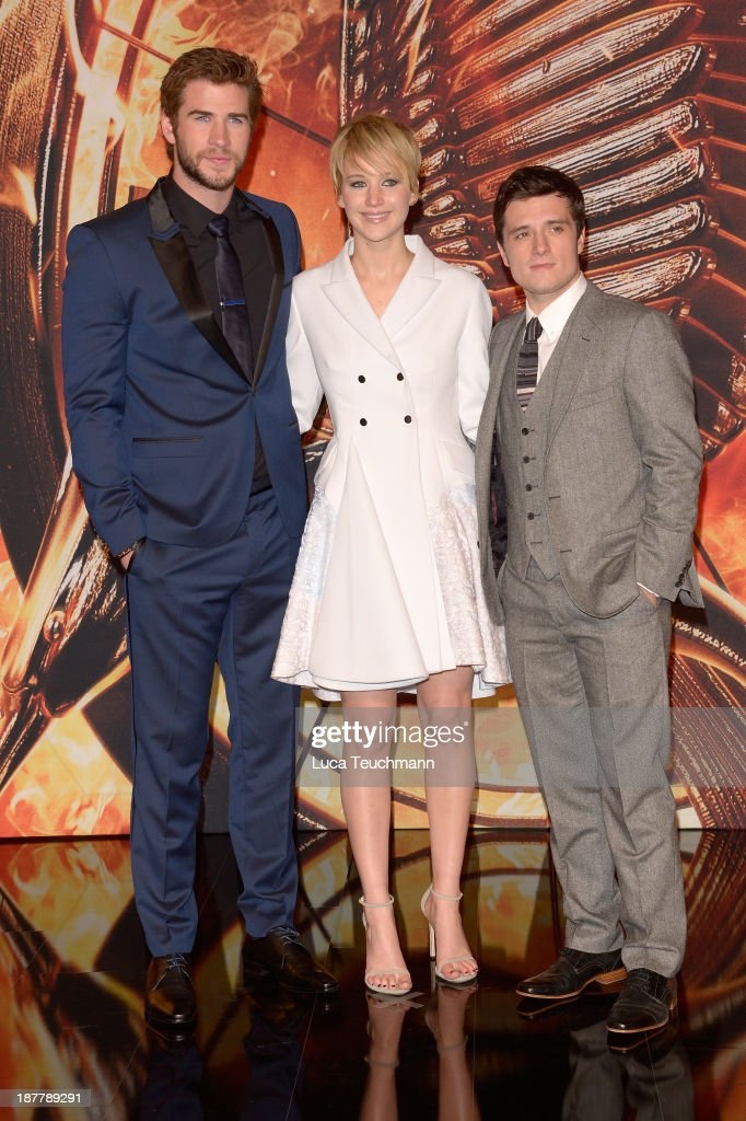 Liam Hemsworth, Jennifer Lawrence and Josh Hutcherson attend the German premiere of the film 'The Hunger Games - Catching Fire' (Tribute von Panem - Catching Fire) at Sony Centre on November 12, 2013 in Berlin, Germany.