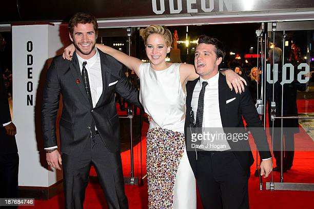 Liam Hemsworth Jennifer Lawrence and Josh Hutcherson attends the UK Premiere of The Hunger Games Catching Fire at Odeon Leicester Square on November...