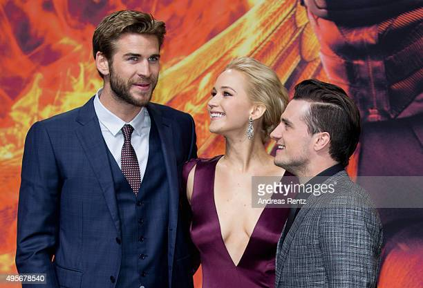 Liam Hemsworth, Jennifer Lawrence, wearing a Dior dress and Josh Hutcherson attend the world premiere of the film 'The Hunger Games: Mockingjay -...