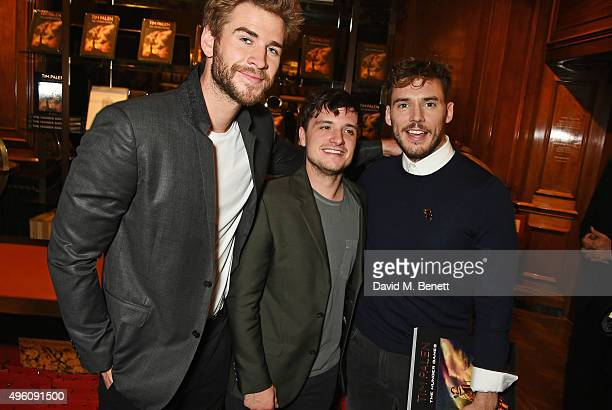 Liam Hemsworth Josh Hutcherson and Sam Claflin attend the book launch of Tim Palen Photographs From The Hunger Games at Maison Assouline on November...