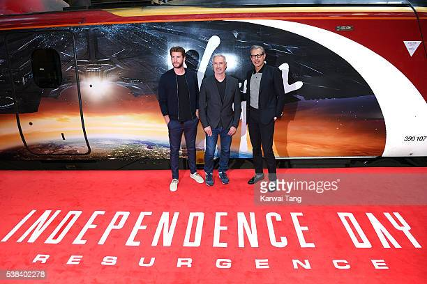 Liam Hemsworth Roland Emmerich and Jeff Goldblum attend the official unveiling of the Independence Day Resurgence wrapped train at Euston Station on...