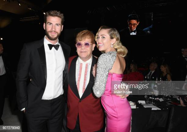 Liam Hemsworth Sir Elton John and Miley Cyrus attend the 26th annual Elton John AIDS Foundation Academy Awards Viewing Party with cocktails by Clase...