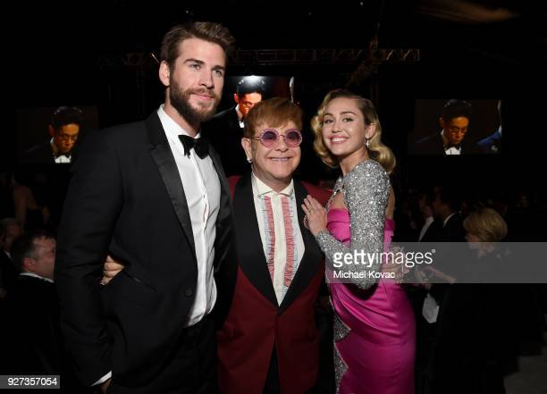 Liam Hemsworth Sir Elton John and Miley Cyrus attend the 26th annual Elton John AIDS Foundation Academy Awards Viewing Party sponsored by Bulgari...