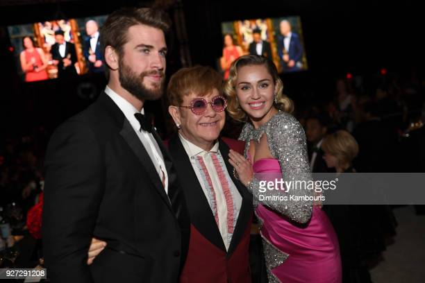Liam Hemsworth Sir Elton John and Miley Cyrus attends the 26th annual Elton John AIDS Foundation Academy Awards Viewing Party sponsored by Bulgari...