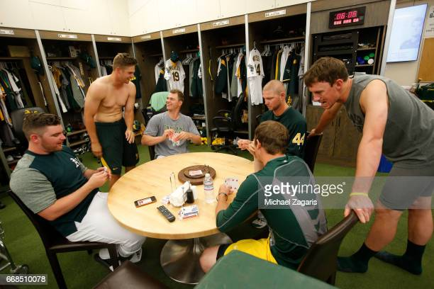 Liam Hendriks Kendall Graveman Sonny Gray Ryan Madson Chris Bassitt and Ryan Dull of the Oakland Athletics play cards in the clubhouse prior to the...
