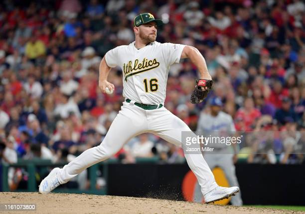 Liam Hendriks of the Oakland Athletics and the American League pitches against the National League during the 2019 MLB AllStar Game presented by...