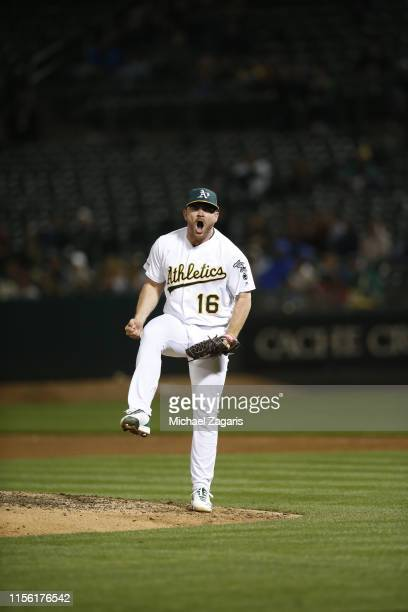 Liam Hendriks of the Oakland Athletics celebrates after recording a strikeout during the game against the Los Angeles Angels of Anaheim at the...