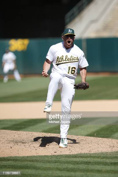 Liam Hendriks of the Oakland Athletics celebrates picking up the save following the game against the Tampa Bay Rays at the OaklandAlameda County...