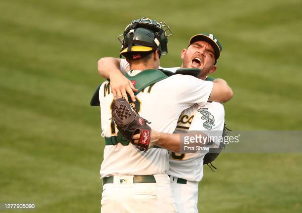 Liam Hendriks of the Oakland Athletics celebrates with Sean Murphy after they beat the Chicago White Sox 6-4 in Game Three of the American League...