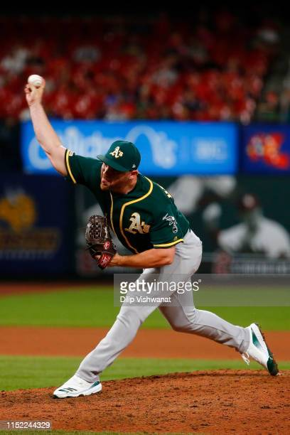Liam Hendriks of the Oakland Athletics delivers a pitch against the St Louis Cardinals in the ninth inning at Busch Stadium on June 26 2019 in St...