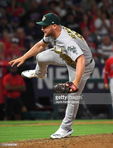 Liam Hendriks of the Oakland Athletics earns a save in the ninth inning of the game against the Los Angeles Angels at Angel Stadium of Anaheim on...